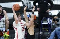 Wisconsin's Nate Reuvers (35) shoots over Penn State's John Harrar (21) during the first half of an NCAA college basketball game at the Big Ten Conference tournament, Thursday, March 11, 2021, in Indianapolis. (AP Photo/Darron Cummings)