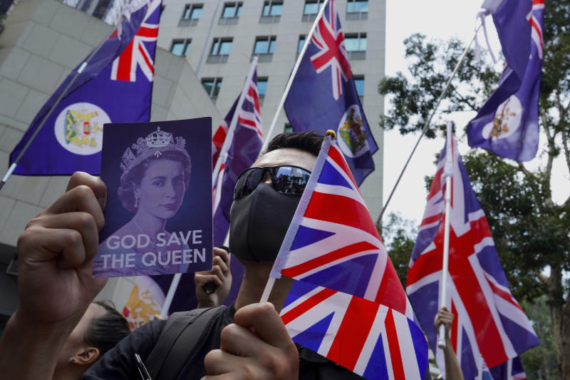 Protesters hold placards and British flags during a peaceful demonstration outside the British Consulate in Hong Kong, Sunday, Sept. 15, 2019. Hundreds of Hong Kong activists rallied outside the Consulate for a second time this month, bolstering calls for international support in their months-long protests for democratic reforms in the semi-autonomous Chinese territory. (AP Photo/Vincent Yu)