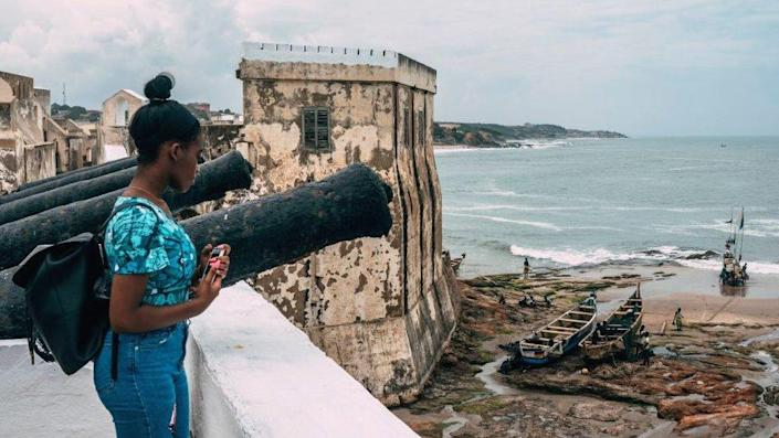 A woman at Ghana's Cape Coast Castle in 2019