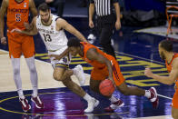 Virginia Tech's Nahiem Alleyne starts to bring the ball up, next to Notre Dame's Nikola Djogo (13) during the first half of an NCAA college basketball game Wednesday, Jan. 27, 2021, in South Bend, Ind. (AP Photo/Robert Franklin)