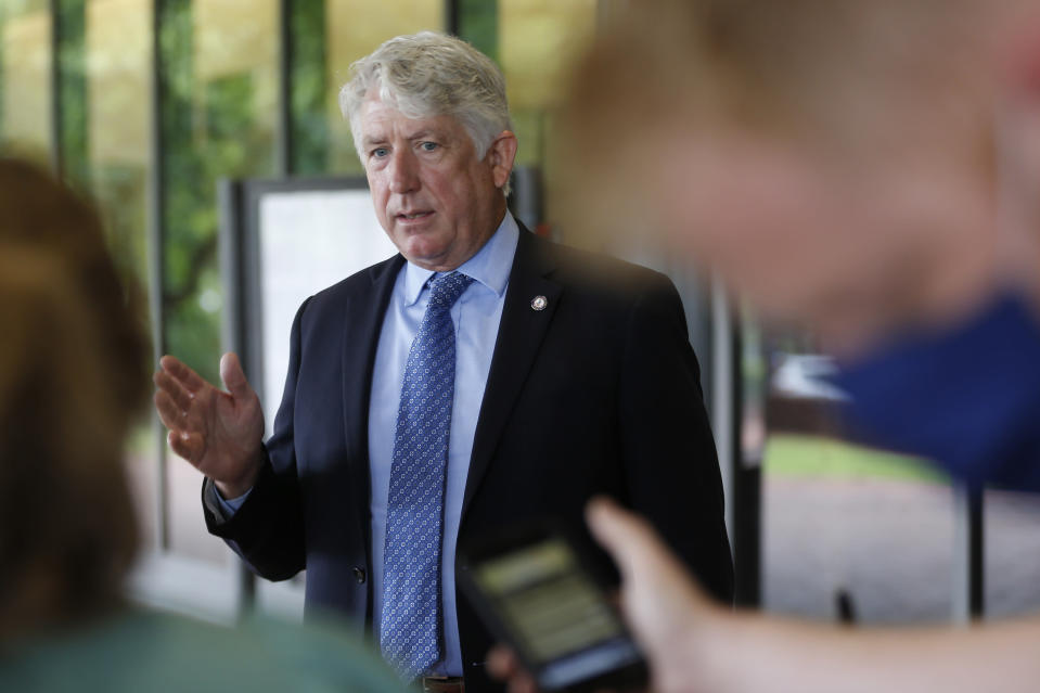 Virginia Attorney General Mark Herring gestures as he speaks with reporters ouside Richmond General District Court Thursday June 18, 2020, in Richmond, Va. Herring responded to questions concerning a judges extension of an injunction preventing the removal of the statue of Confederate General Robert E. Lee on Monument ave. (AP Photo/Steve Helber)
