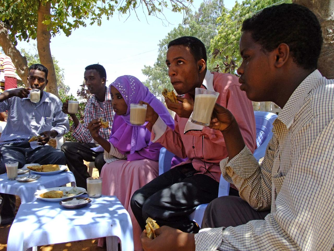 In this photo taken Saturday, March 31, 2012, customers drink coffee at an outdoor cafeteria in Mogadishu, Somalia. The seaside capital of Mogadishu is full of life for the first time in 20 years after African Union and Somali troops pushed Islamist militants out of the city last year. (AP Photo/Farah Abdi Warsameh)