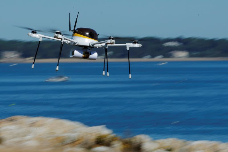 FILE PHOTO: A drone, made by CyPhy Works, carries a UPS package on Children's Island off the coast of Beverly