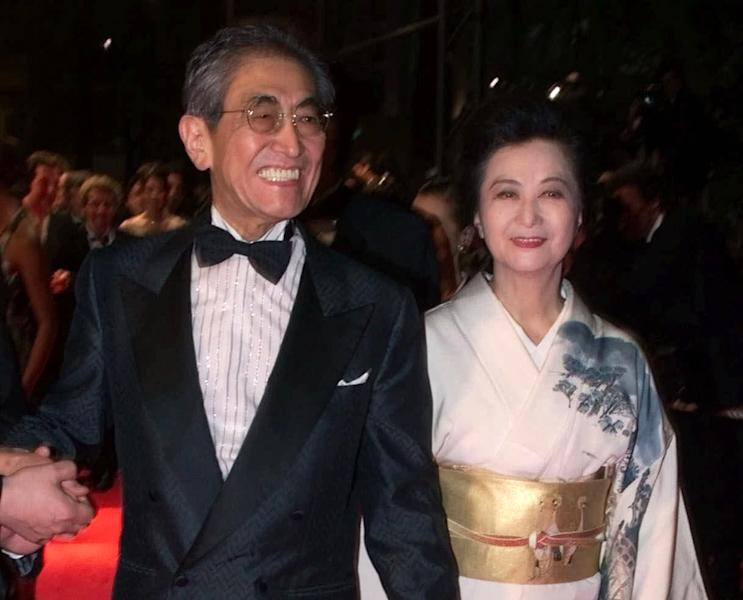 """FILE - In this May 16, 2000 file photo, Japanese director Nagisa Oshima arrives with his wife Akiko Koyama at the Festival Palace to attend the screening of his film """"Gohatto"""" in competition at the 53rd International Film Festival in Cannes. Oshima, a Japanese director known for internationally acclaimed films """"Empire of Passion"""" and """"In the Realm of the Senses"""" has died of pneumonia. He was 80. His office says Oshima died Tuesday afternoon at a hospital near Tokyo. (AP Photo/Laurent Rebours, File)"""
