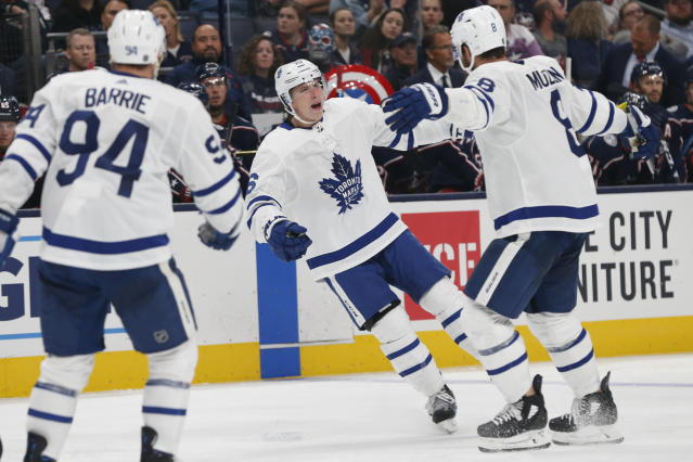 Toronto Maple Leafs' Mitchell Marner, center, celebrates a goal against the Columbus Blue Jackets during the third period of an NHL hockey game Friday, Oct. 4, 2019, in Columbus, Ohio. (AP Photo/Jay LaPrete)