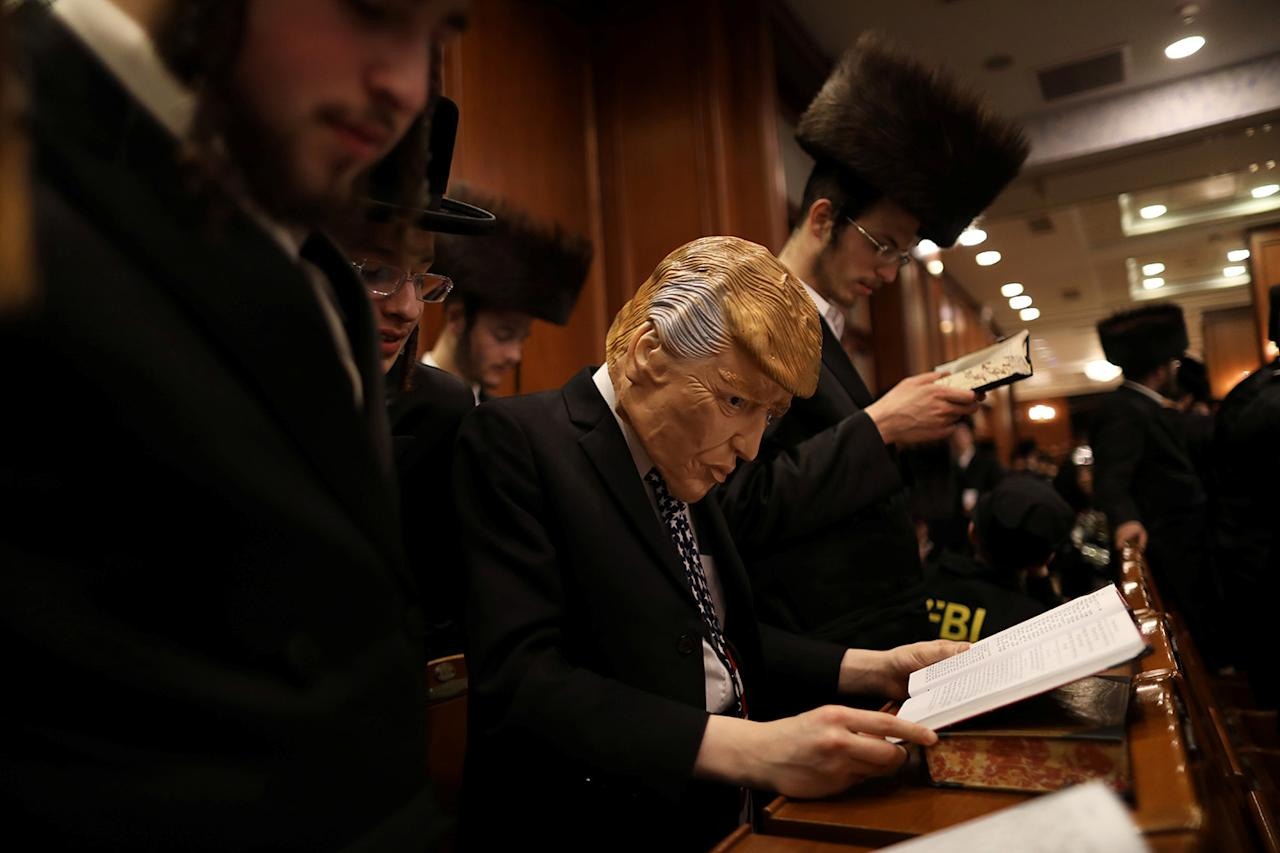 <p>An ultra orthodox Jewish man dressed in the likeness of U.S. President Donald Trump takes part in the reading from the Book of Esther ceremony performed on the Jewish holiday of Purim, a celebration of the Jews' salvation from genocide in ancient Persia, as recounted in the Book of Esther, in Jerusalem March 12, 2017. (Photo: Ammar Awad/Reuters) </p>