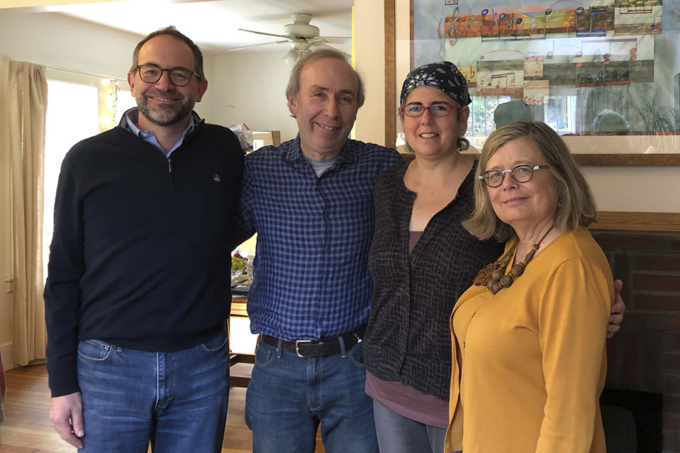 Associated Press Religion Writer Rachel Zoll, second from right, receives a visit in Amherst, Mass., on Oct. 26, 2018, from Managing Editor Brian J. Carovillano, editor at large Jerry Schwartz, and Deputy Managing Editor Sarah L. Nordgren after being awarded an Oliver S. Gramling Journalism Award for being AP's pre-eminent voice on religion for more than a decade. Zoll, who for 17 years as a religion writer for The Associated Press endeared herself to colleagues, competitors, and sources with her warm heart and world-class reporting skills, has died after a three-year bout with brain cancer. She was 55. (Cheryl Zoll via AP)