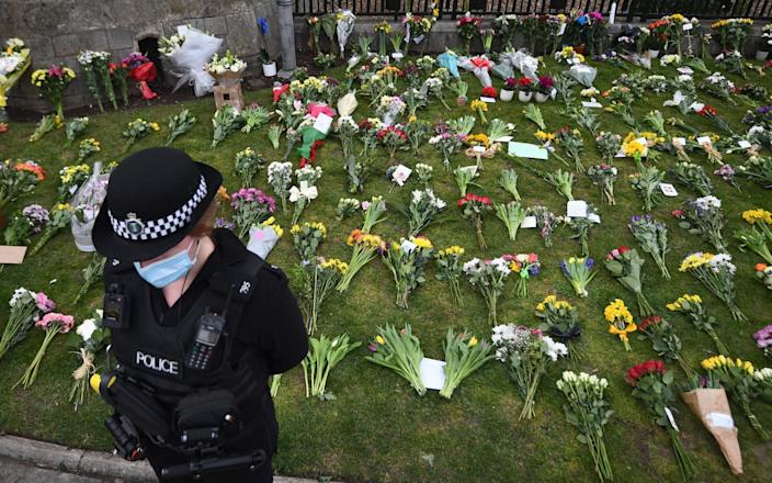 Flowers at Cambridge Gate in Windsor Castle, Berkshire after the announcement of the death of the Duke of Edinburgh at the age of 99-Victoria Jones / Pennsylvania & # xa0;