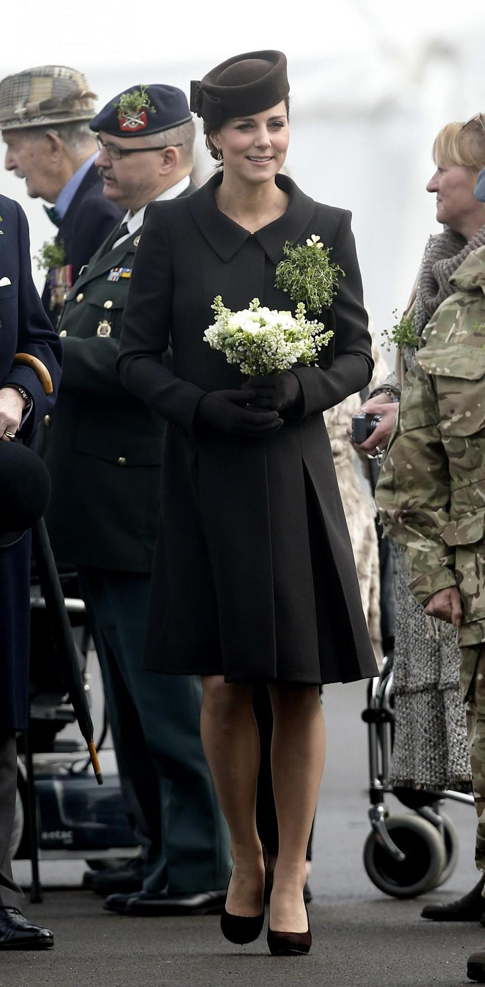 <p>The Duchess pinned both the late Queen Mother's gold shamrock brooch to her label and a bouquet of shamrocks. <em>[Photo: PA]</em> </p>
