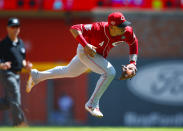 Cincinnati Reds shortstop Jose Iglesias (4) fields a ground ball and throw to first in the sixth inning of a baseball game against the Atlanta Braves, Sunday, Aug.4, 2019, in Atlanta. (AP Photo/Todd Kirkland)