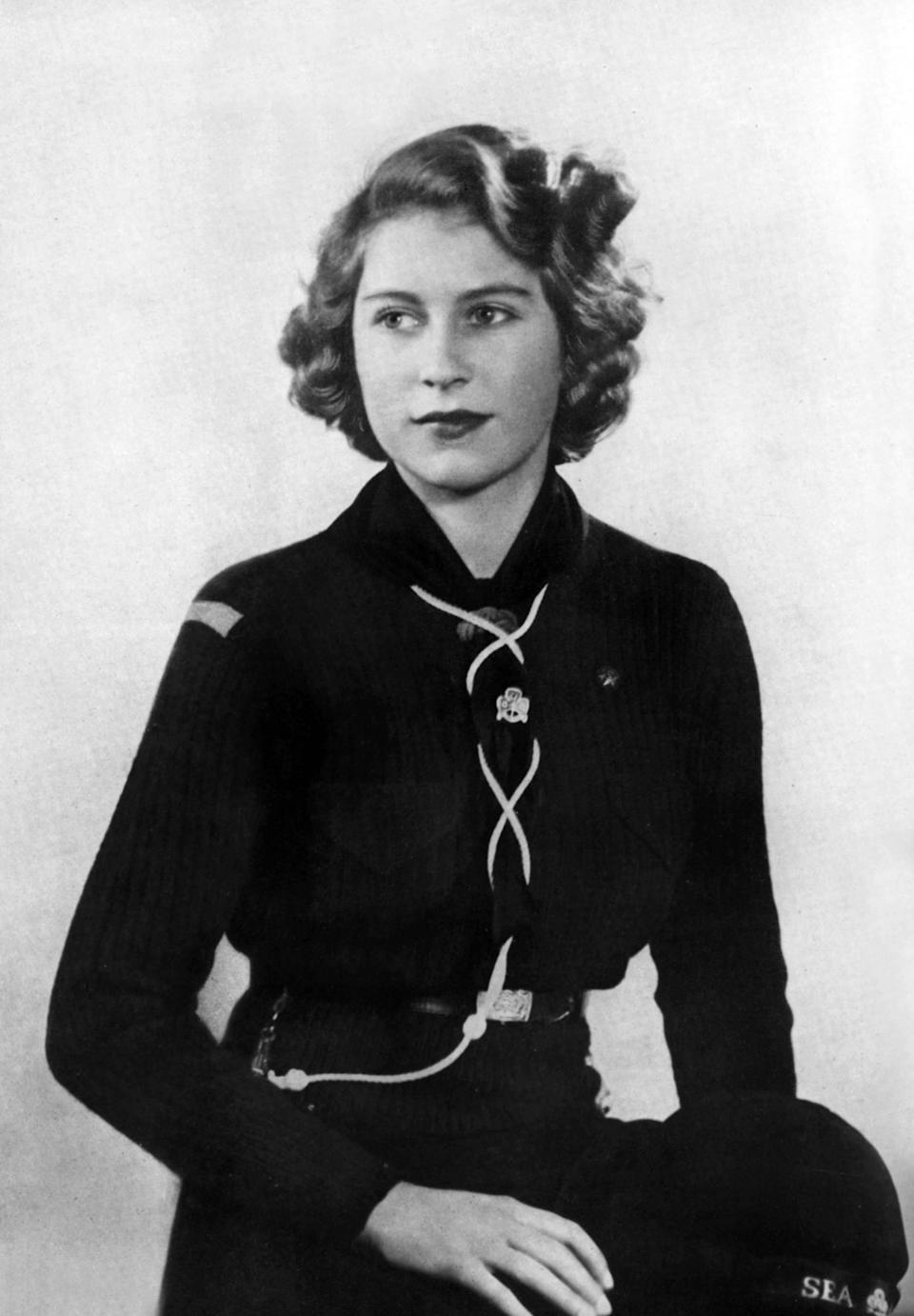 """<div class=""""caption-credit""""> Photo by: Getty Images</div>Princess Elizabeth of England and future Queen Elizabeth II posed in a Buckingham Palace Company of Girl Guides uniform at age 17. <br>"""