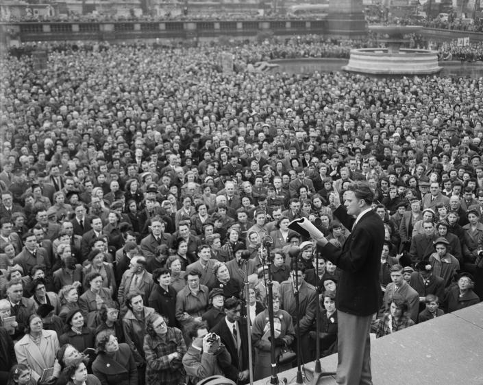 Evangelist Billy Graham preaches to a rapt audience in Trafalgar Square, London, April 12, 1954. (Photo: AP)
