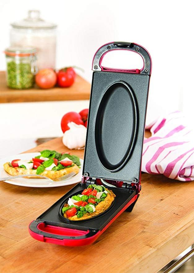 "<p>Breakfast will be easy with this brilliant <a href=""https://www.popsugar.com/buy/Dash-Omelette-Maker-408512?p_name=Dash%20Omelette%20Maker&retailer=amazon.com&pid=408512&price=23&evar1=savvy%3Aus&evar9=45913800&evar98=https%3A%2F%2Fwww.popsugar.com%2Fhome%2Fphoto-gallery%2F45913800%2Fimage%2F45913966%2FDash-Omelette-Maker&list1=shopping%2Camazon%2Cgadgets%2Cgift%20guide%2Ckitchen%20tools%2Ckitchens%2Ctech%20shopping&prop13=api&pdata=1"" rel=""nofollow"" data-shoppable-link=""1"" target=""_blank"" class=""ga-track"" data-ga-category=""Related"" data-ga-label=""https://www.amazon.com/Dash-Omelette-Maker-Stick-Plates/dp/B01FMHQ9BO/ref=sr_1_10?s=home-garden&amp;ie=UTF8&amp;qid=1548702621&amp;sr=1-10&amp;keywords=omelette+maker"" data-ga-action=""In-Line Links"">Dash Omelette Maker</a> ($23).</p>"