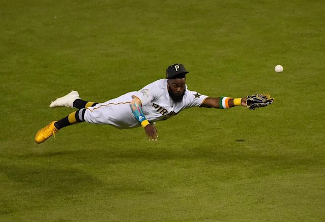 <p>National League infielder Josh Harrison (5) of the Pittsburgh Pirates dives for but cannot field a ball hit for a single by American League infielder Yonder Alonso (not pictured) of the Oakland Athletics in the ninth inning during the 2017 MLB All-Star Game at Marlins Park. (Jasen Vinlove-USA TODAY Sports) </p>