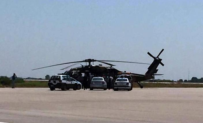 Greek police vehicles encircle a Turkish military helicopter at Alexandroupolis airport on July 16, 2016 after it landed carrying eight officers seeking asylum after a coup bid in Turkey (AFP Photo/)