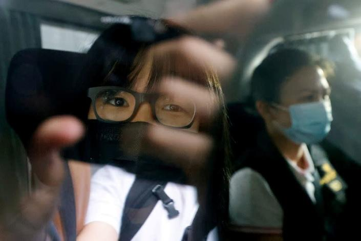 FILE PHOTO: Hong Kong Alliance in Support of Patriotic Democratic Movements of China Vice-Chairwoman Tonyee Chow is seen inside a vehicle after being detained in Hong Kong