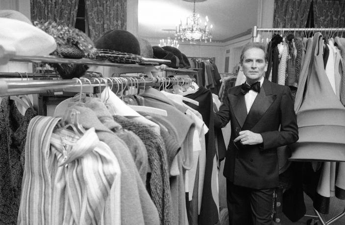 FILE - In this Oct.30 1975 file photo, French designer Pierre Cardin poses in the dressing room at Hotel Pierre in New York. France's Academy of Fine Arts says famed fashion designer Pierre Cardin has died at 98 (AP Photo/Ray Stubblebine, File)