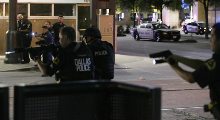Police investigate a car shortly after the shooting during a protest in downtown Dallas. (Photo: LM Otero/AP)