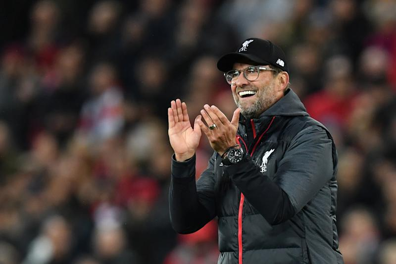 Liverpool's German manager Jurgen Klopp celebrates after winning the English Premier League football match between Liverpool and Tottenham Hotspur at Anfield in Liverpool, north west England on October 27, 2019. (Photo by Paul ELLIS / AFP) / RESTRICTED TO EDITORIAL USE. No use with unauthorized audio, video, data, fixture lists, club/league logos or 'live' services. Online in-match use limited to 120 images. An additional 40 images may be used in extra time. No video emulation. Social media in-match use limited to 120 images. An additional 40 images may be used in extra time. No use in betting publications, games or single club/league/player publications. / (Photo by PAUL ELLIS/AFP via Getty Images)