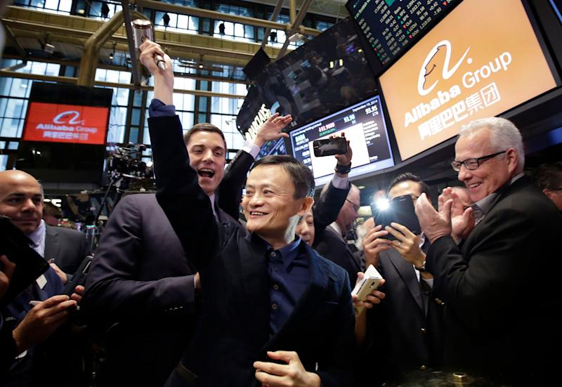 Jack Ma Alibaba founder Jack Ma, center, raises a ceremonial mallet before striking a bell during the company's IPO at the New York Stock Exchange, in New York.
