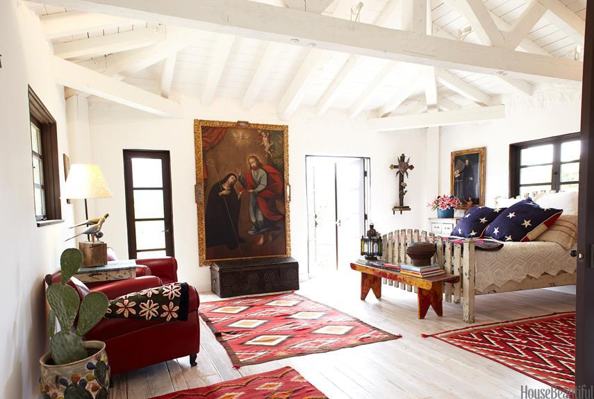 """<div class=""""caption-credit""""> Photo by: Victoria Pearson</div><div class=""""caption-title"""">Stars-and-Stripes Bedroom</div><p> Religious art, stars and stripes, and Navajo rugs are surprisingly harmonious in the master bedroom of designer Kelley McDowell's Ojai, California, farmhouse. The bed was made from an old picket fence. Paintings and trunk from Mediterranee Antiques. Flag pillows by Laurel Adams Design. Rugs from Ranchfolks. </p> <p> <b>See more:</b> </p> <p> <a rel=""""nofollow noopener"""" href=""""http://www.housebeautiful.com/shopping/best/4th-of-july-entertaining-ideas?link=emb&dom=yah_life&src=syn&con=blog_housebeautiful&mag=hbu"""" target=""""_blank"""" data-ylk=""""slk:11 Chic Finds for 4th of July Party"""" class=""""link rapid-noclick-resp""""><b>11 Chic Finds for 4th of July Party</b></a> <br> <br> <a rel=""""nofollow noopener"""" href=""""http://www.housebeautiful.com/decorating/home-makeovers/summer-home-decorating-ideas?link=emb&dom=yah_life&src=syn&con=blog_housebeautiful&mag=hbu"""" target=""""_blank"""" data-ylk=""""slk:50+ Easy Summer Decorating Ideas"""" class=""""link rapid-noclick-resp""""><b>50+ Easy Summer Decorating Ideas</b></a> </p>"""