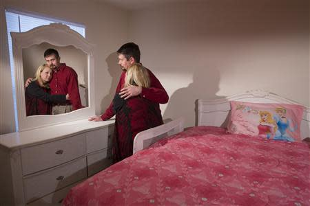Amanda and Bryan Alexander stand in their adopted daughter's bedroom in Fort Oglethorpe, Georgia