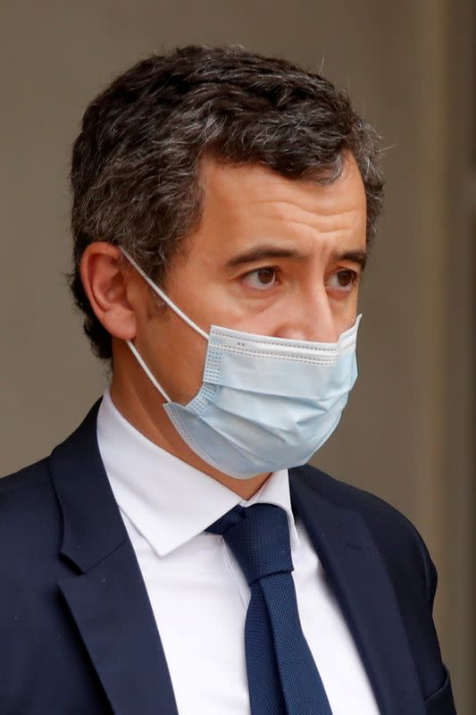 FILE PHOTO: French Interior Minister Gerald Darmanin, wearing a protective face mask, leaves after a weekly cabinet meeting