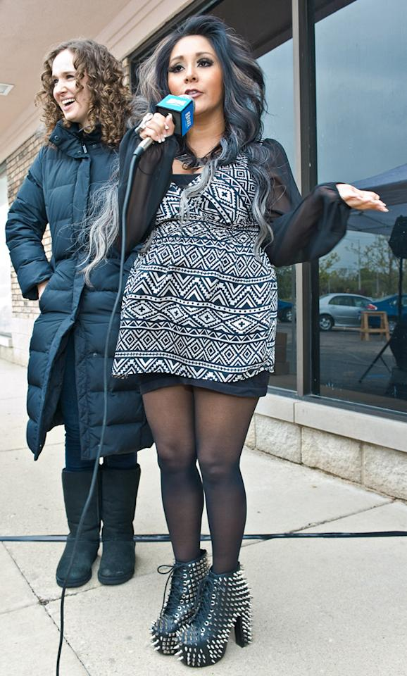 Snooki rocked a pair of studded Jeffery Campbell shoes at the Ultimate Exposure Salon in Chicago to promote her line of indoor tanning lotions by Supre Tan on April 28, 2012.