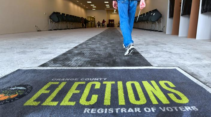 <p>A voter holds onto his ballot while entering an Early Vote Center in Huntington Beach, Calif., on Oct. 27, 2018, as voting begins in the traditional Republican stronghold of Orange County. (Photo by Frederic J. Brown/AFP//Getty Images) </p>
