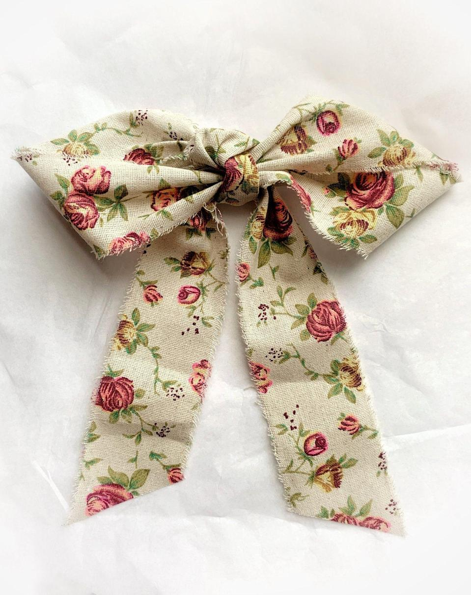 """<p>leletny.com</p><p><strong>$98.00</strong></p><p><a href=""""https://leletny.com/products/rose-garden-linen-bow?_pos=3&_sid=d3411c7d9&_ss=r"""" rel=""""nofollow noopener"""" target=""""_blank"""" data-ylk=""""slk:Shop Now"""" class=""""link rapid-noclick-resp"""">Shop Now</a></p><p>""""Even before days were filled with Zoom calls and hair styling was even more important than before I was fully on the hair accessory bandwagon. For summer I have been gravitating toward lighter weight fabric bows and headbands and setting to the side my satin and velvet options. I have been eyeing this linen option from Lelet NY to pair with all my summer dresses.""""—<em>Cassandra Hogan, Fashion Assistant</em></p>"""
