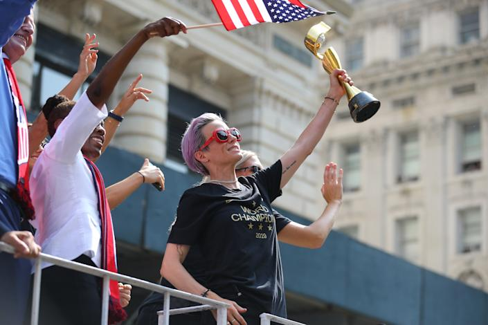 Megan Rapinoe holds the Women's World Cup trophy as the U.S. women's soccer team is celebrated with a parade along the Canyon of Heroes, Wednesday, July 10, 2019, in New York. (Photo: Gordon Donovan/Yahoo News)