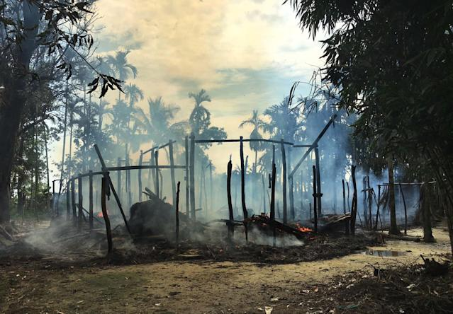 <p>Smoke rises from a burned house in Gawdu Zara village, northern Rakhine state, Myanmar Thursday, Sept. 7, 2017. Journalists saw new fires burning Thursday in the Myanmar village that had been abandoned by Rohingya Muslims, and where pages from Islamic texts were seen ripped and left on the ground. (Photo: AP) </p>