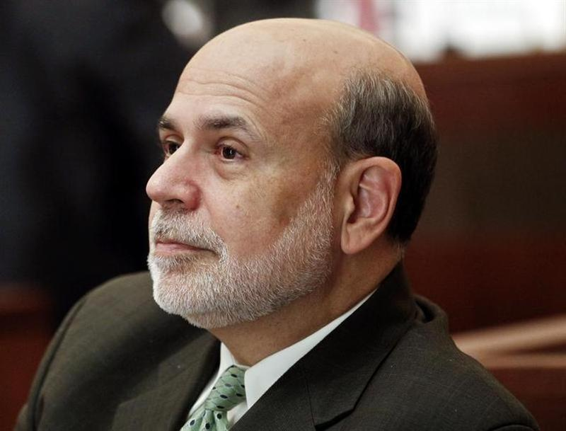 """Ben Bernanke, chairman of the Federal Reserve, listens to a presentation during the """"Community Banking in 21st Century"""" conference at the Federal Reserve Bank of St. Louis in St. Louis"""