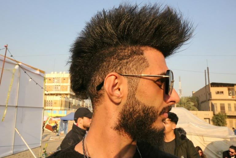 Iraqi anti-government protesters are expressing their rebellion against the existing social order via wild hairstyles (AFP Photo/SABAH ARAR)