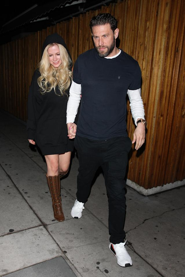 Avril Lavigne and J.R Rotem hold hands as they leave the Nice Guy restaurant in West Hollywood on Oct. 9. 2017. (Photo: Photographer Group/Splash News)