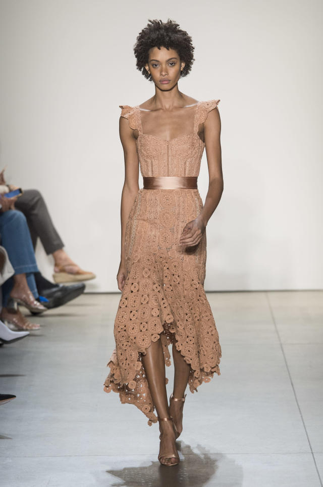 <p><i>Model wears a peach winged-shoulder dress from the SS18 Jonathan Simkhai collection. (Photo: ImaxTree) </i></p>