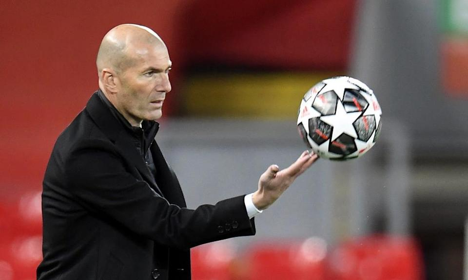 Zinedine Zidane collects the ball on the Anfield touchline.