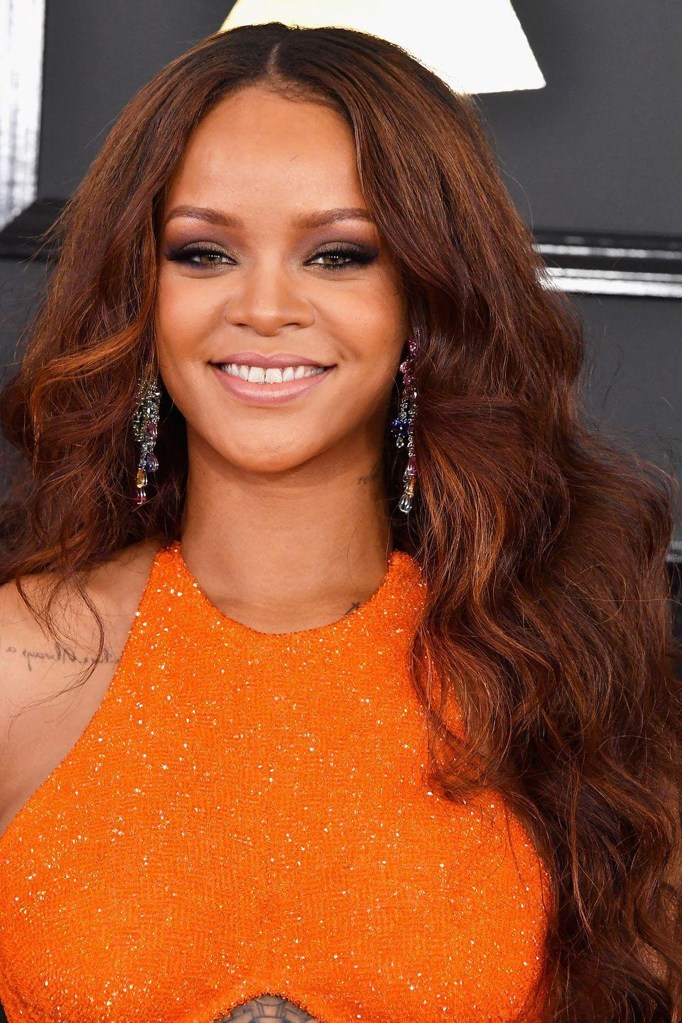 <p>Rihanna wears her wavy red hair long and with lots of volume. </p>