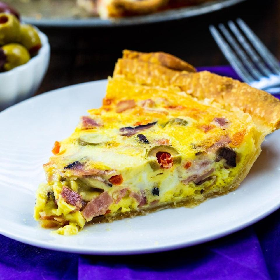 """<p>Breakfast is served! This muffaletta quiche is filled to the brim with chopped olives, roasted red peppers, ham, salami, mortadella, and provolone cheese. You'll notice that all the ingredients in this dish are consistent with the ones in the iconic New Orleans sandwich that everyone loves so much, so cheers to that.</p> <p><strong>Get the recipe</strong>: <a href=""""https://spicysouthernkitchen.com/muffaletta-quiche/"""" class=""""link rapid-noclick-resp"""" rel=""""nofollow noopener"""" target=""""_blank"""" data-ylk=""""slk:muffaletta quiche"""">muffaletta quiche</a></p>"""