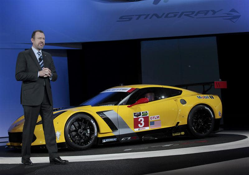 Daniel Ammann, President of GM, speaks next to the Chevrolet Corvette Stingray C7R racing version during the press preview day of the North American International Auto Show in Detroit