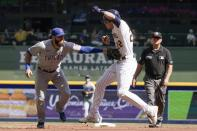Chicago Cubs' David Bote tags out Milwaukee Brewers' Christian Yelich after being caught in a rundown during the first inning of a baseball game Sunday, Sept. 19, 2021, in Milwaukee. (AP Photo/Morry Gash)