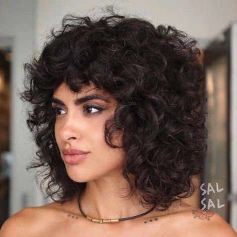 <p>Nothing flatters a head full of curls like a classic shag. It's definitely the cool girl cut of the bunch.</p>
