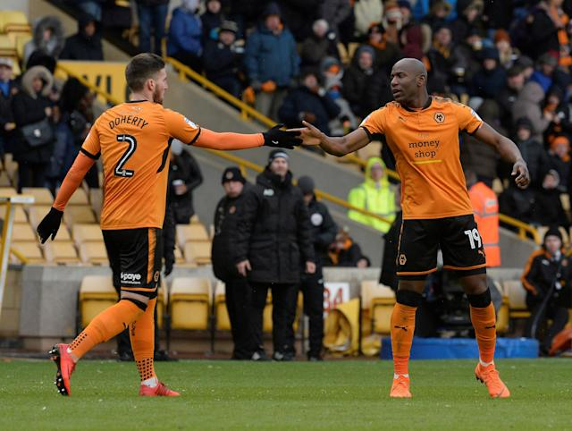 "Soccer Football - Championship - Wolverhampton Wanderers vs Burton Albion - Molineux Stadium, Wolverhampton, Britain - March 17, 2018 Wolves' Benik Afobe celebrates scoring their third goal with Matt Doherty Action Images/Alan Walter EDITORIAL USE ONLY. No use with unauthorized audio, video, data, fixture lists, club/league logos or ""live"" services. Online in-match use limited to 75 images, no video emulation. No use in betting, games or single club/league/player publications. Please contact your account representative for further details."