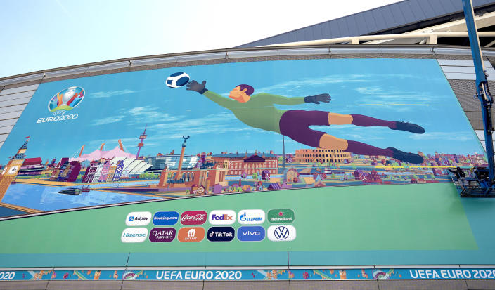 Workers put the final touch to a painting at Wembley stadium in the build-up to the upcoming Euro 2020 soccer championship in London, Wednesday, June 9, 2021. Euro 2020 kicks-off on Friday June 11 when Italy face Turkey in Rome. (AP Photo/Frank Augstein)