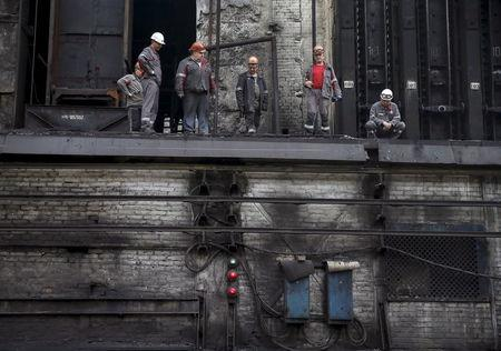 Workers are seen at a coke plant in the town of Avdiyivka near Donetsk, eastern Ukraine