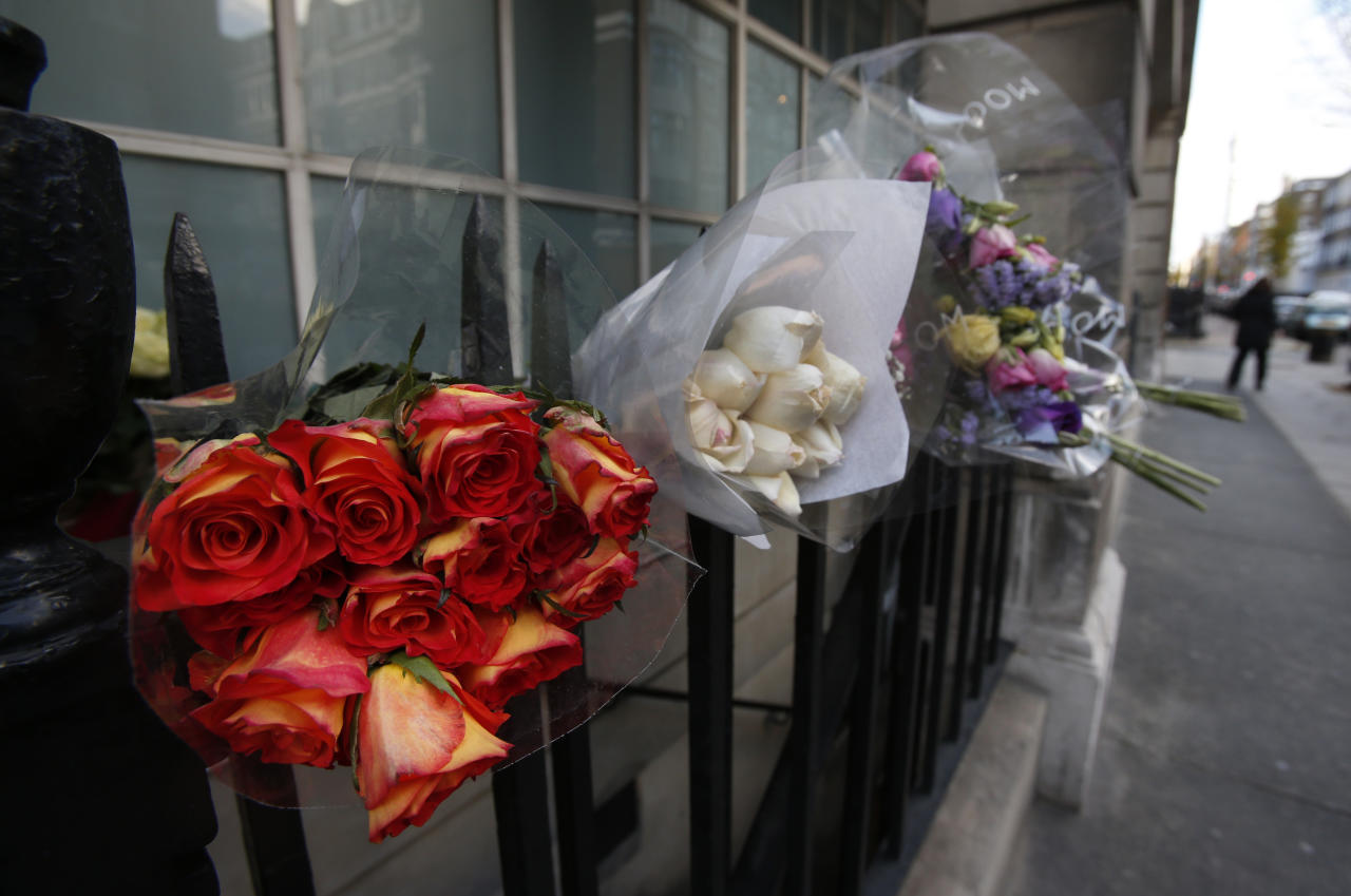 Flower tributes to late nurse Jacintha Saldanha are seen outside the residential apartments of the the King Edward VII hospital where she was found dead, in central London, Monday, Dec. 10, 2012. Australian radio hosts managed to impersonate Queen Elizabeth II and Prince Charles and received confidential information about the Duchess of Cambridge's medical condition, in a hoax phone call to the hospital where the pregnant Duchess was staying and which was broadcast on-air. The controversial prank took a dark twist three days later with the death of nurse Saldanha, a 46-year-old mother of two, who was duped by the DJs despite their Australian accents. (AP Photo/Lefteris Pitarakis)