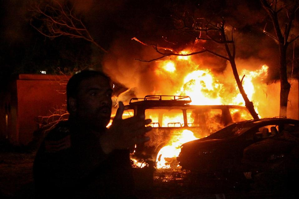 <p>A police officer reacts after an explosion at a luxury hotel in Quetta, Pakistan </p> (Reuters)