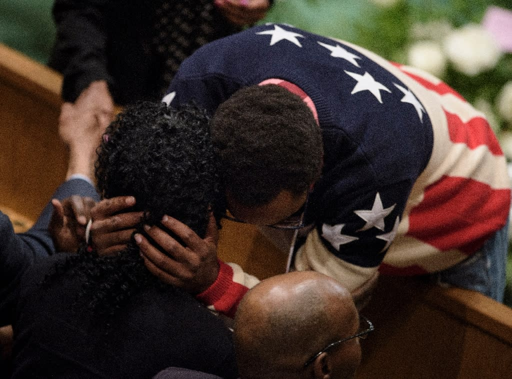 Gloria Darden is embraced while waiting before her son Freddie Gray's funeral at New Shiloh Baptist Church April 27, 2015 in Baltimore, Maryland (AFP Photo/Brendan Smialowski)