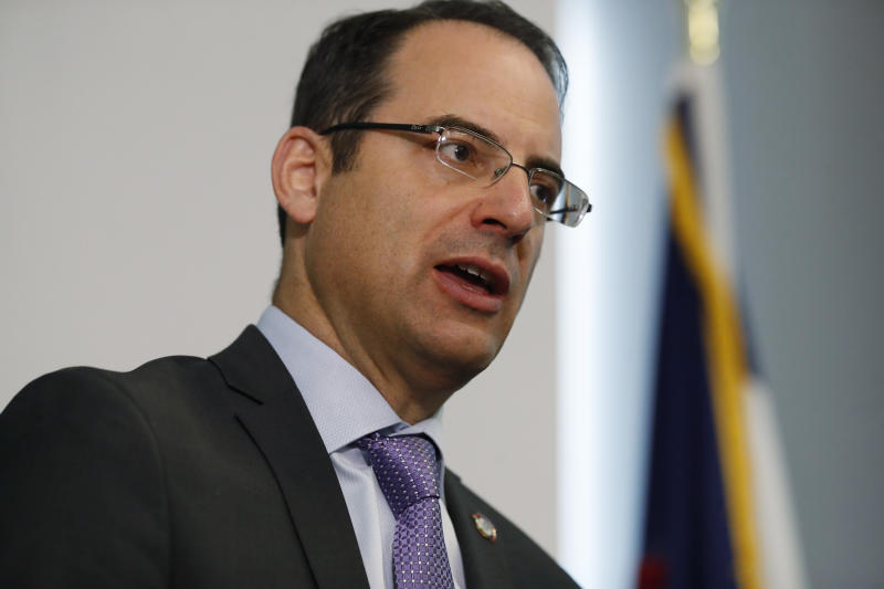 FILE - In this Monday, Oct. 7, 2019, file photo, Colorado Attorney General Phil Weiser speaks during a news conference in Denver. Weiser and Colorado Secretary of State Jena Griswold announced Wednesday, Oct. 16, 2019, that they will be asking the U.S. Supreme Court to consider to roll back an appeals court ruling that allows Electoral College members to vote for presidential candidates of their choice rather than cast ballots bound by the state's popular vote. (AP Photo/David Zalubowski)
