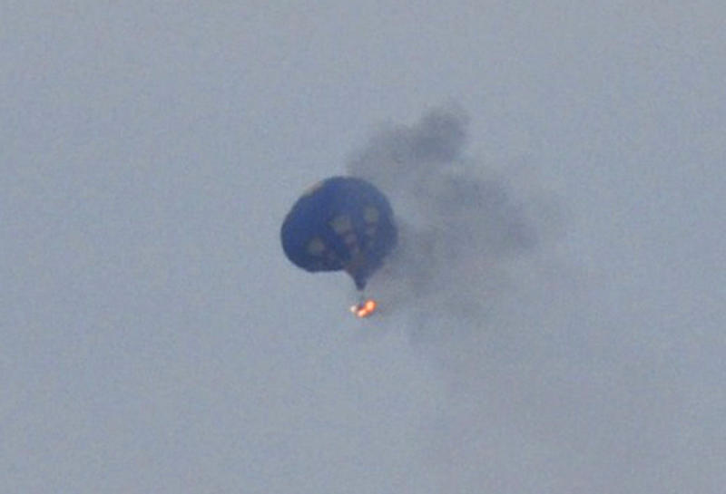 A hot air balloon on fire is pictured north of Richmond